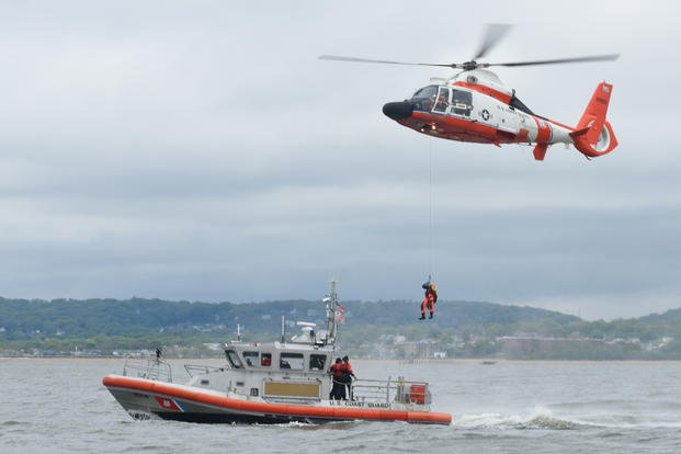 COAST GUARD HELICOPTER RESCUES 3 COMMERCIAL FISHERMEN